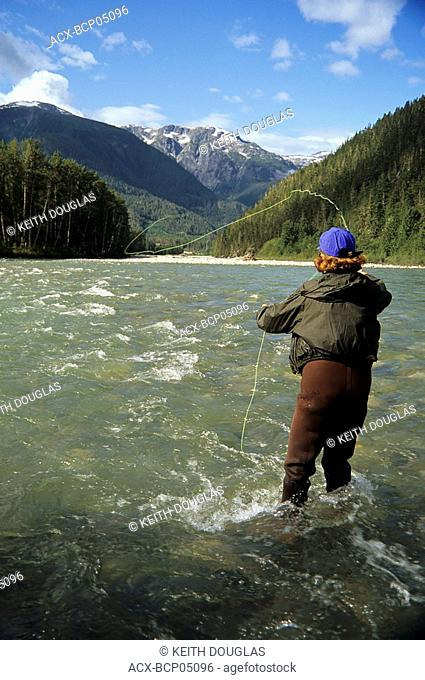Flyfisherman casting for summer run steelhead, Dean river, British Columbia, Canada