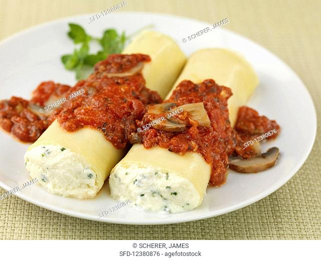 Manicotti filled with ricotta with a tomato and mushroom sauce
