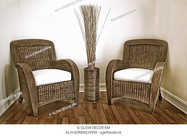 Armchairs with a decorative urn