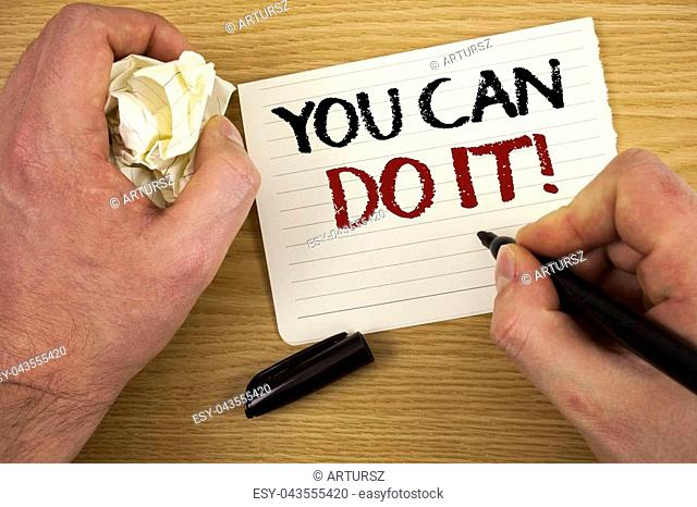 Handwriting text You Can Do It Motivational Call. Concept meaning Inspirational Message Motivational Positive Text two words white paper note black marker hand...
