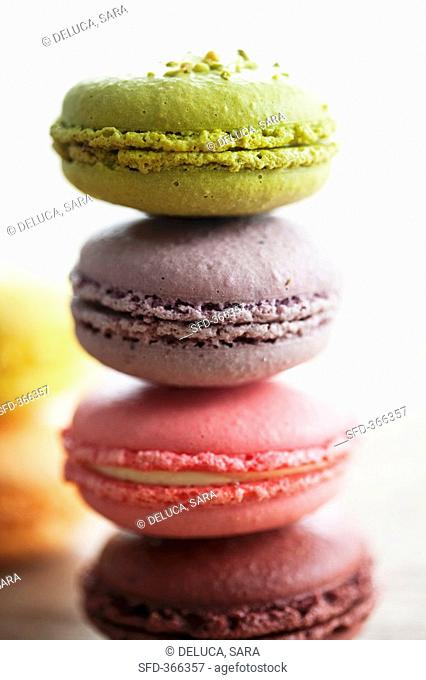 Different coloured macarons small French cakes, stacked
