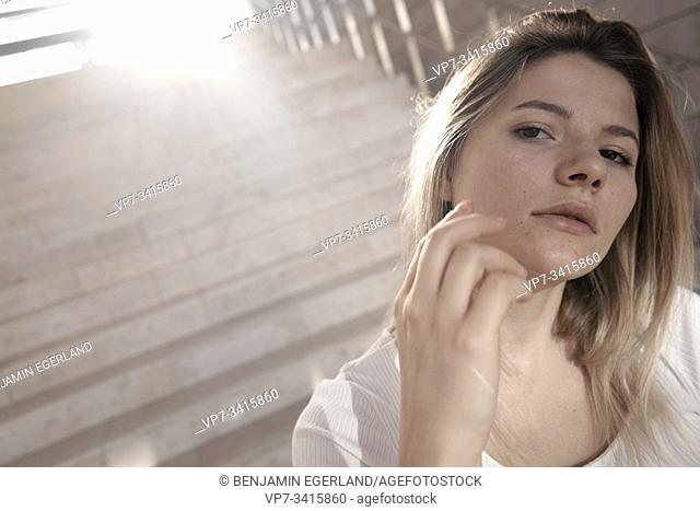 Portrait of young woman on steps