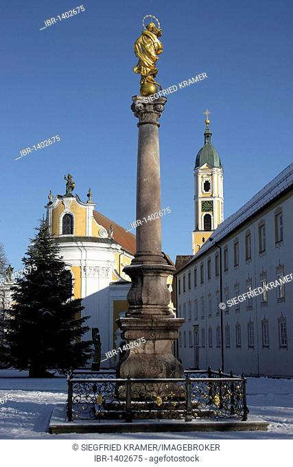 Marian column from 1717, in the back the abbey church of St. George, monastery, Ochsenhausen, Landkreis Biberach district, Upper Swabia, Baden-Wuerttemberg