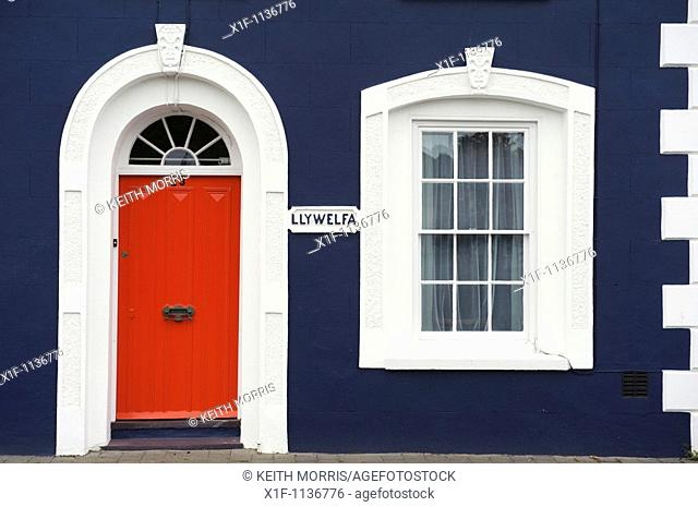Red painted door on a blue house, Aberaeron, Ceredigion, West Wales UK