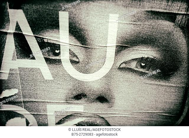 "Close up of commercial sign showing a woman's face and letters ""AU"". London, England"