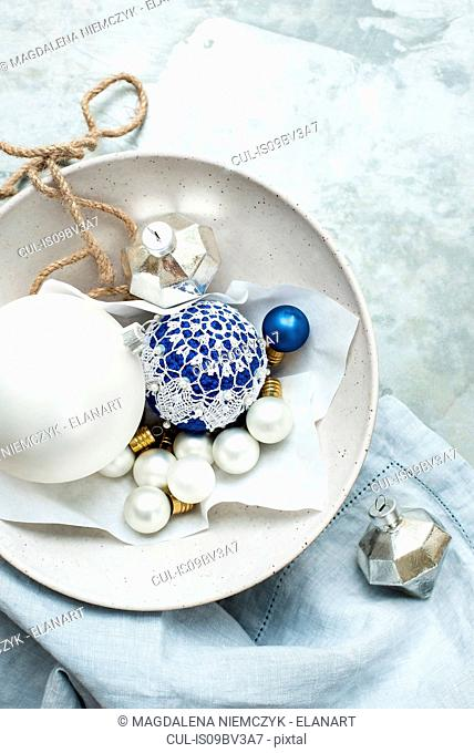 Christmas baubles and ornaments on linen cloth