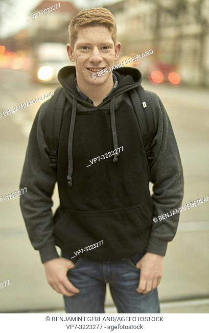 portrait of young man at street, in Munich, Germany