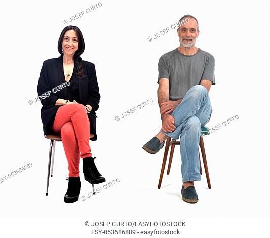 couple sitting on a vintage chair isolated on white