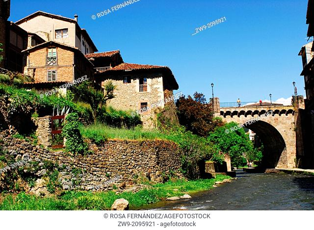 River and houses in Potes, Picos de Europa Range, Region of Cantabria, Spain