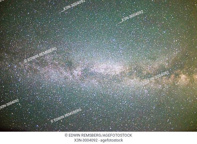 Bright stars illuminate the night sky, Grand Tetons National Park, Teton County, Wyoming. USA