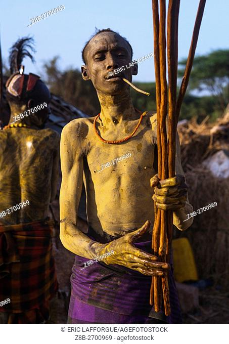 Ethiopia, Omo Valley, Omorate, dassanech man preparing the long sticks for dimi ceremony to celebrate circumcision of teenagers