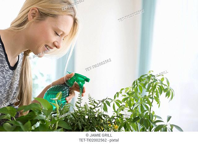 Woman spraying plants