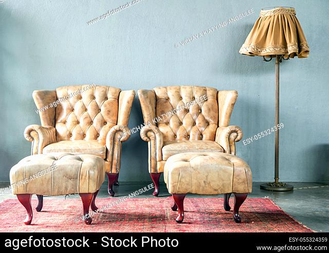 genuine leather classical style sofa in vintage room with desk lamp