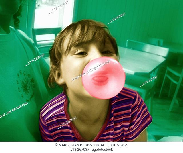 Girl blowing big bubble