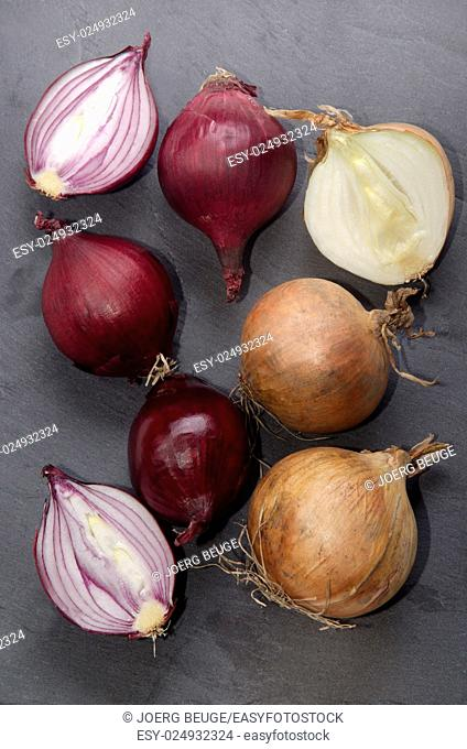 purple and white organic onion on slate