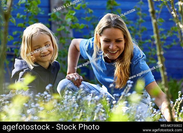 Happy mother and daughter in allotment garden