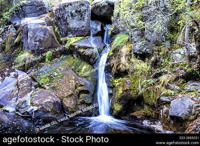 Waterfall at Iruelas river. Sierra de Gredos. Avila. Spain. Europe