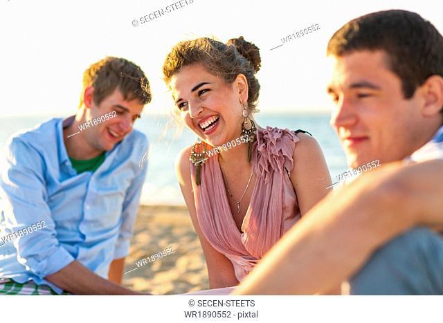 Young people celebrating on the beach, Dalmatia, Croatia