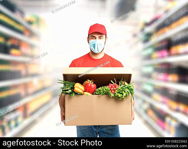Delivery company worker holding grocery box, food order, supermarket service