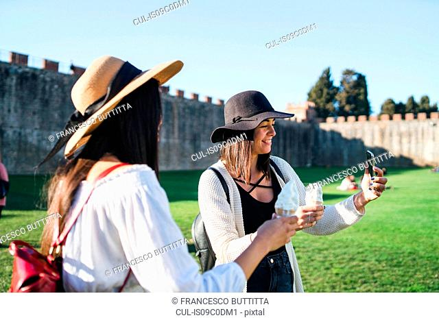 Friends taking selfie with ice cream cone, Pisa, Toscana, Italy