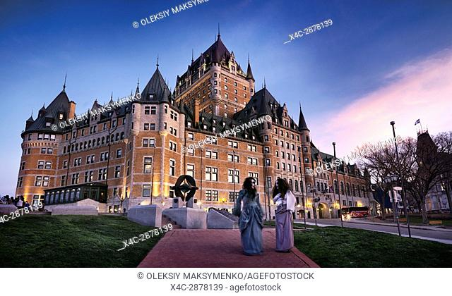 Ghost tour guides in front of Fairmont Le Château Frontenac grand hotel Chateau Frontenac in Old Quebec City, Quebec, Canada. Ville de Québec