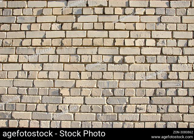 White brick wall. Abandoned architectural details backdrop