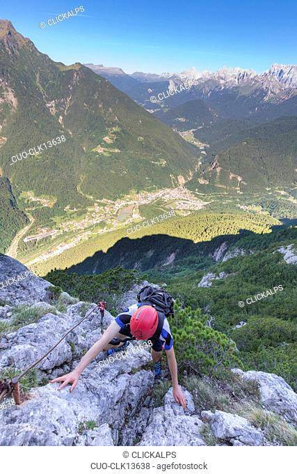 Mountain climber on the via ferrata Fiamme Gialle at Palazza Alta of Pelsa, Civetta group, Agordo, Dolomites, Veneto, Italy, Europe