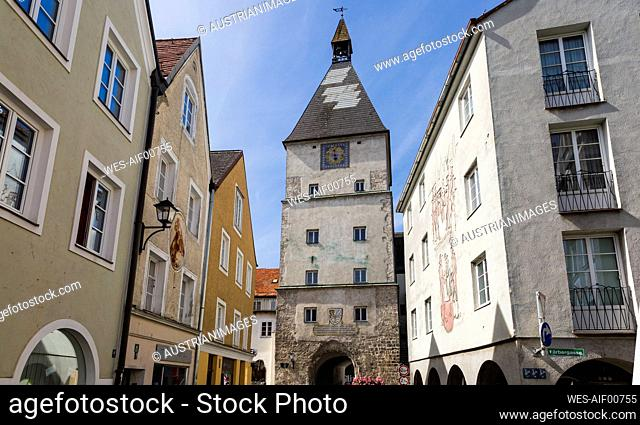 Town gate tower amidst buildings in Braunau am Inn, Upper Austria, Austria