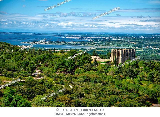 France, Herault, Gigean, Gardiole Hills, Abbey Saint-Felix-de-Montceau with Thau lagoon in the background