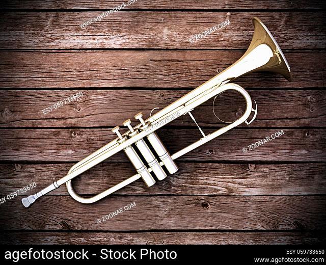 Trumpet on wood background - 3D render