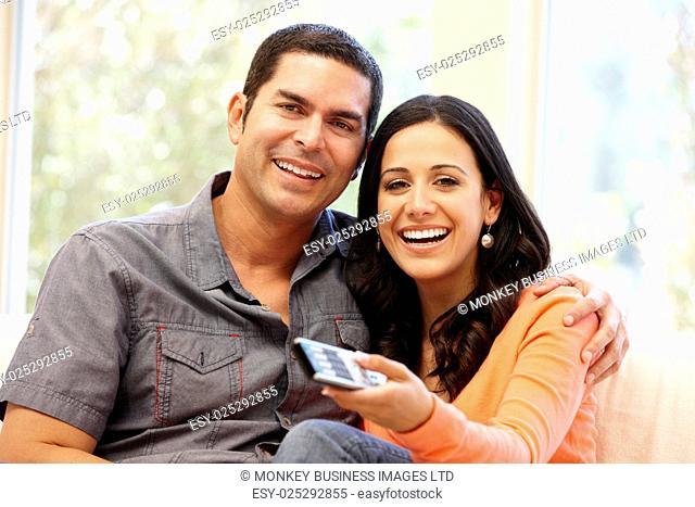 Hispanic couple watching television