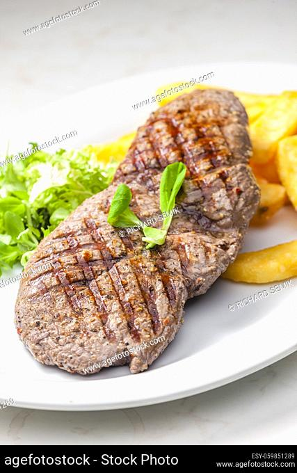 beef steak with homemade french fries and vegetable salad