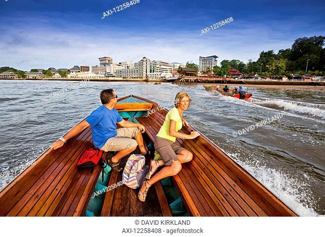 A couple taking a river boat ride; Bandar Seri Begawan, Brunei