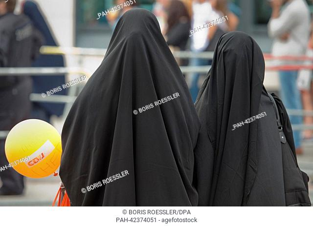 Two women completely covered by a veil with a CDU balloon attend an event of radical Islamic preacher Pierre Vogel in Frankfurt/Main, Germany, 07 September 2013