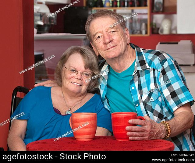 Smiling Senior Male and Female at Table