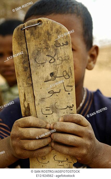 Coranic tablet, nomad family near Chinguetti, Adrar Plateau, Sahara desert, Mauritania