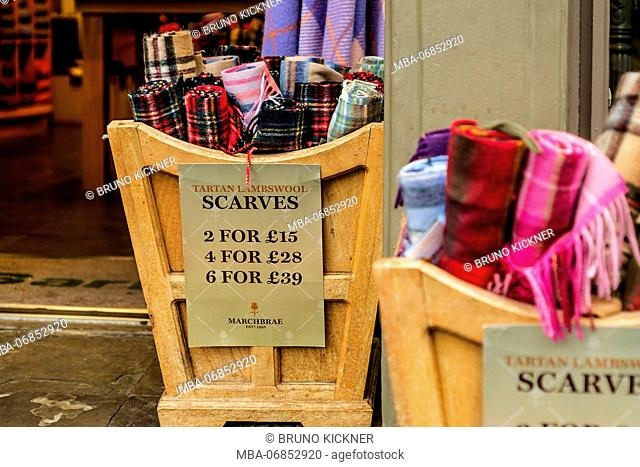 In a business numerous scarfs are offered in different variations in wooden boxes, Edinburgh, Highland, Scotland