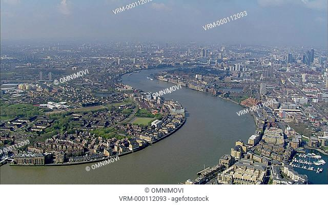 Aerial view of River Thames and London skyline with London Gherkin in background facing west