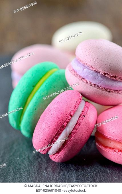 Colorful macaroons on ardesia stone plate