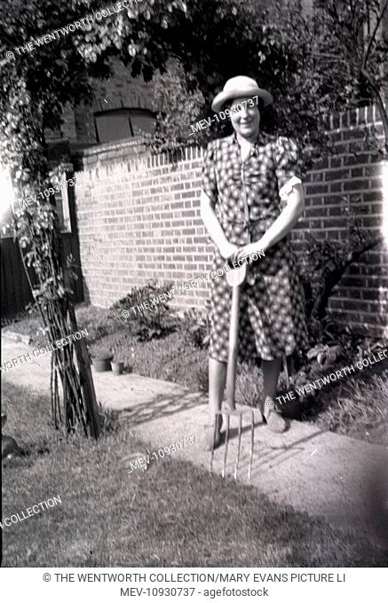 Lady in Garden, Hullbridge, Hockley, near South Woodham Ferrers, Essex, England