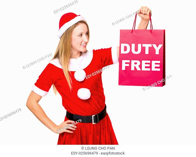 Christmas woman hold with shopping bag showing duty free