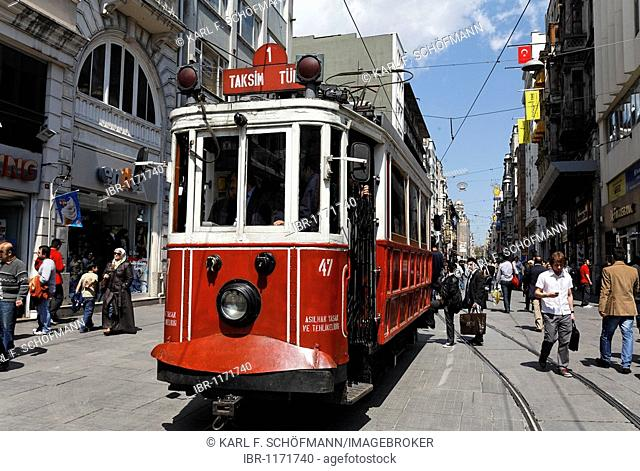 Historical Tram Taksim Tuenel driving on the Istiklal Caddesi, Independence Street, Beyoglu, Istanbul, Turkey