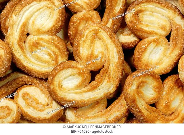 Baked puff pastries known as Schweinsoehrchen (pig's ears)