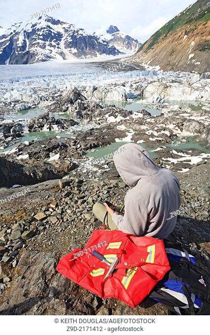 Geologists assistant exploring for minerals, Salmon Glacier area, Stewart, British Columbia