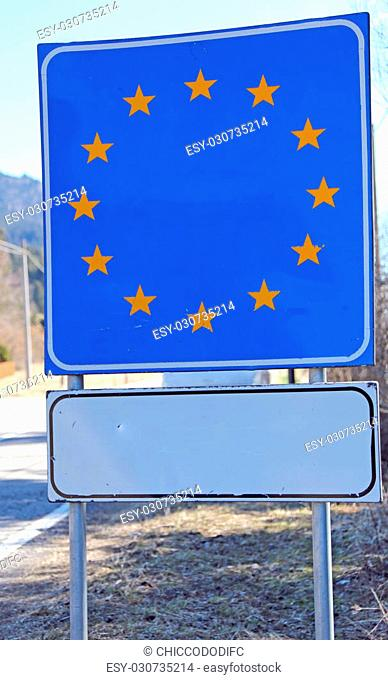 road sign with yellow stars in the border area of a European border