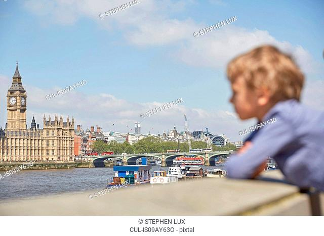 Boy looking at view of river thames