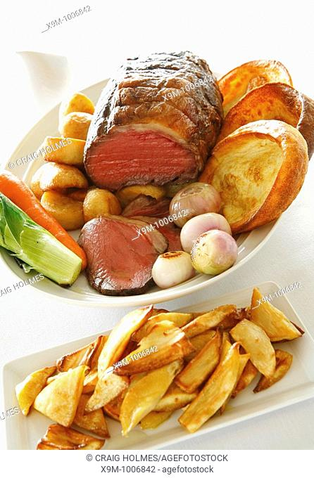 Roast beef and yorkshire pudding with vegetable accompaniment