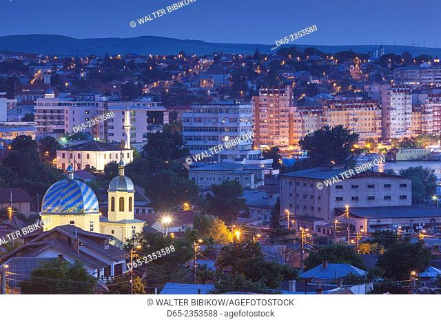 Romania, Danube River Delta, Tulcea, elevated town view from Monument Hill, dusk