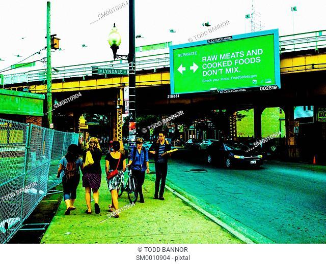 Scene on California Avenue south of Milwaukee Avenue, Logan Square neighborhood of Chicago. Blue Line elevated rapid transit tracks