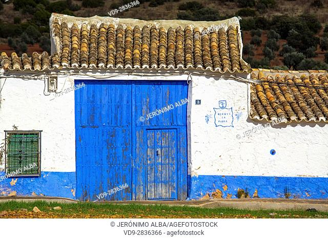 Blue entrance doors to a farmhouse. Puerto Lapice, Ciudad Real province, Castilla La Mancha, Spain Europe